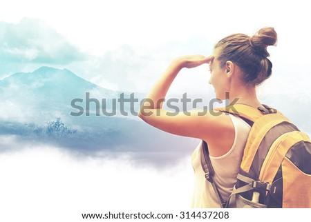 Woman traveler looking at Batur volcano. Indonesia. - stock photo