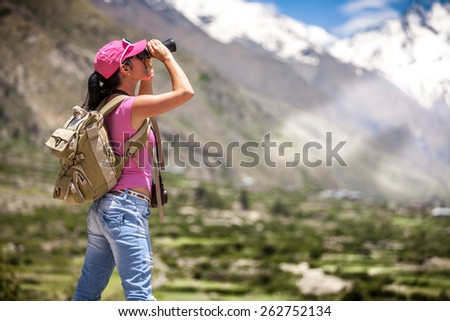 Woman traveler looks into the distance - stock photo