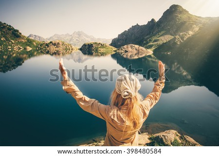 Woman Traveler meditating harmony with nature Travel healthy Lifestyle concept lake and rocky mountains landscape on background outdoor  - stock photo