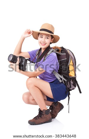 Woman traveler with a camera on white background