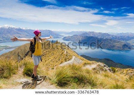 Woman Traveler with Backpack hiking in Mountains. New Zealand. Lake wanaka and Mt Aspiring - stock photo