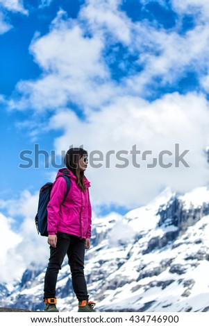 Woman Traveler with Backpack hiking in Mountains with beautiful summer landscape on background mountaineering sport lifestyle concept - stock photo