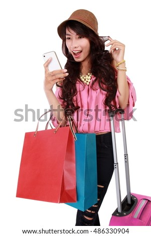 woman traveling with a shopping bag and play mobile phone, isolated on white background