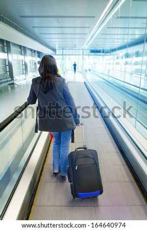 Woman traveling with luggage - stock photo