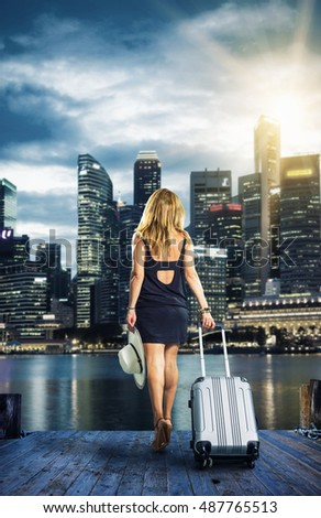 Woman traveller with suitcase  in Singapore