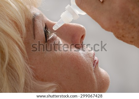 woman treats his eyes medicine close - stock photo