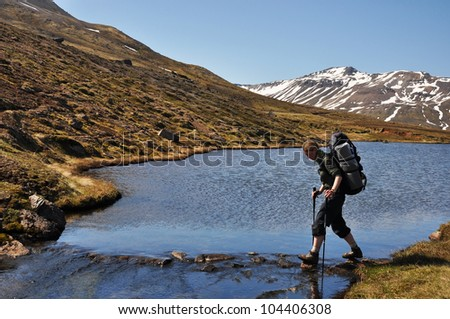 Woman trekking in mountain - stock photo