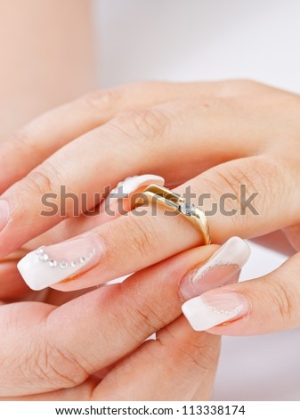 Woman tries on engagement ring - stock photo