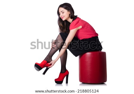 Woman trying new shoes isolated on the white - stock photo