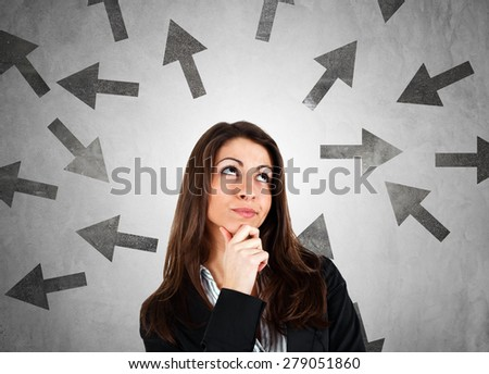 Woman trying to choose the right path - stock photo