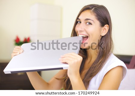 Woman trying to eat pc/Technology is my food - stock photo