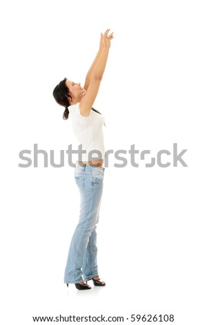 Woman trying to reach something with her hand - stock photo