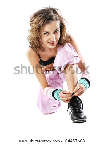 Woman tying shoelaces - stock photo