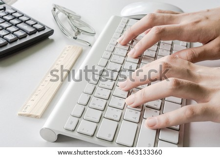 woman typing on computer keyboard, Low light, selective focus on hand, can be used for e-commerce, business, technology and internet concept, Vintage tone filter