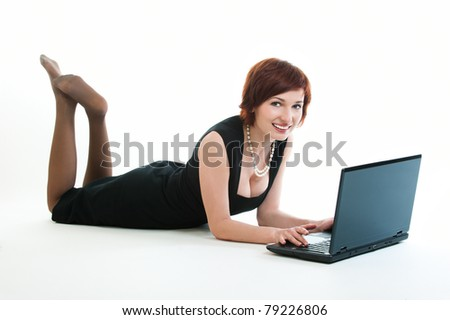 Woman typing on laptop computer against white background