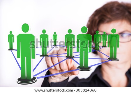 Woman typing on network with human figures