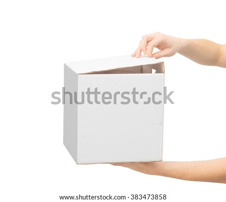woman unboxing parcel, woman holding cardboard box and opening cap. Clipping path. - stock photo
