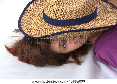 Woman under a cowboy's hat - stock photo