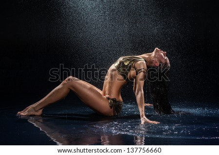 Woman under rain. Studio photo