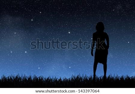 Woman under the night sky - stock photo