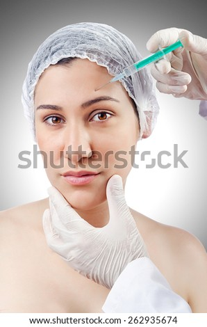 Woman under the plastic surgery - stock photo