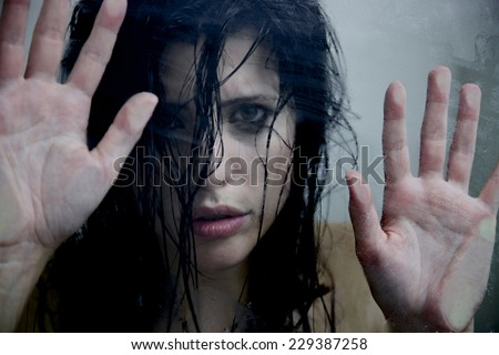Woman under the shower after abuse crying - stock photo