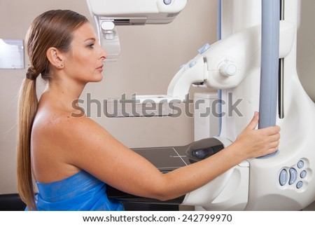 Woman undergoing mammography scan. - stock photo