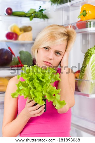woman unhappy fresh green salad diet, refrigerator open door, sad girl negative emotion dieting healthy food vegetables