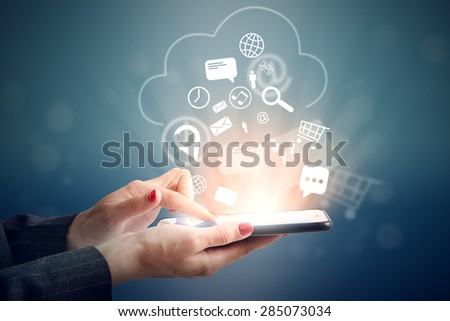 woman uploading her data at cloud storage - stock photo
