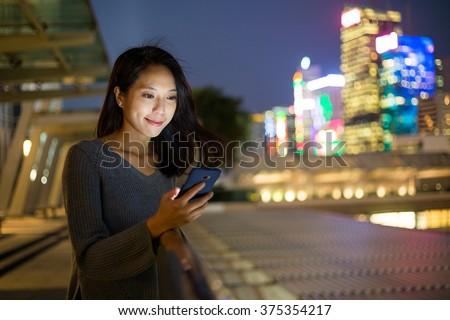 Woman use cellphone at night