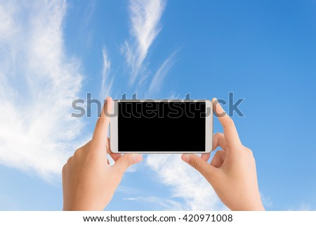 woman use mobile phone and image of blue sky with clouds