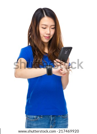 Woman use mobile phone connect to wearable watch