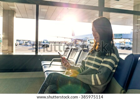 Woman use of cellphone at airport