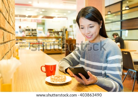Woman use of cellphone at coffee shop - stock photo