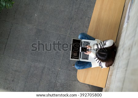 Woman use of mobile phone and laptop computer
