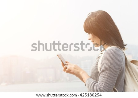 Woman use of mobile phone at outdoor - stock photo