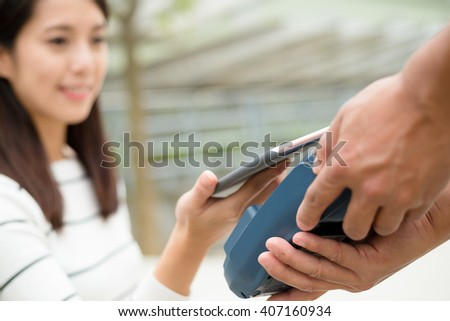 Woman use of mobile phone to pay  - stock photo