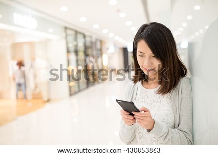 Woman use of smart phone in shopping mall