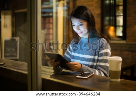 Woman use of tablet pc in coffee shop - stock photo