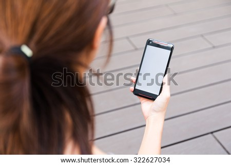 Woman use of the cellphone at outdoor - stock photo