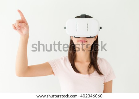 Woman use of virtual reality - stock photo