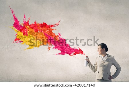 Woman use paint spray