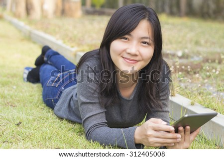 Woman Use Tablet at Park