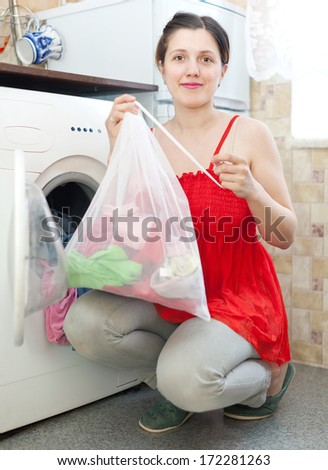 Woman uses bag for laundry at her home