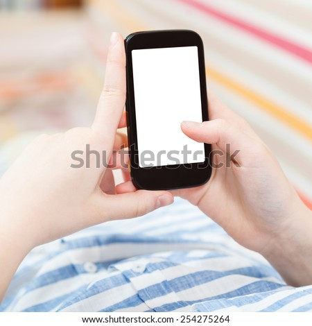 woman uses smart phone with cut out screen in living room - stock photo