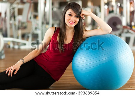 Woman using a ball to work out - stock photo