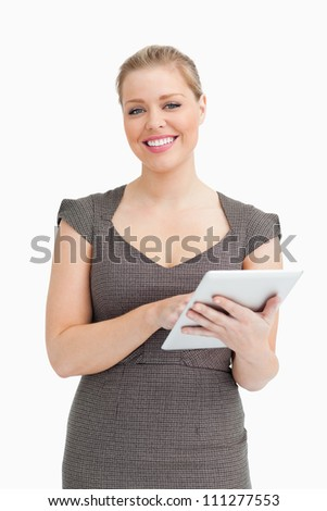 Woman using a digital computer against white background