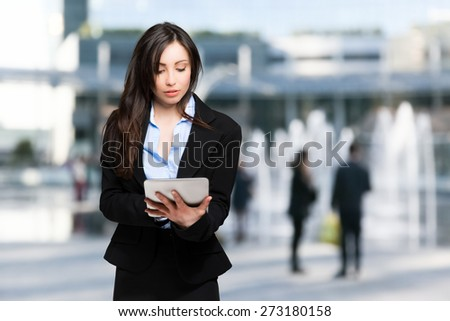 Woman using a digital tablet outdoor - stock photo