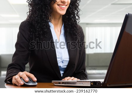 Woman using a laptop computer in her office