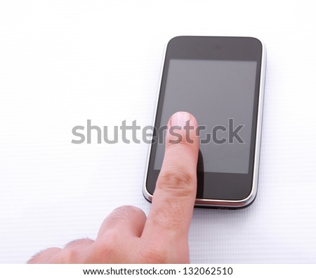 woman using a mobile smart phone isolated on white background - stock photo